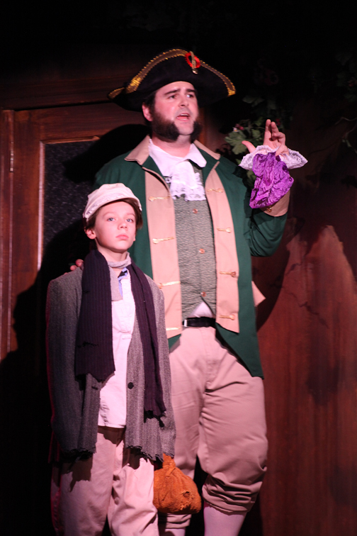 Alexander Lawless plays Oliver and James Desmond portrays Mr. Bumble in Oliver!, on stage through July 6 at Limelight Theatre, 11 Old Mission Ave.