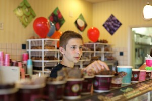 Kyle Thompson, a St. Augustine student who participates in the Kidzfactory program at Limelight Theatre and who will play an orphan in the upcoming musical Oliver!, scoops ice cream on May 30 at Marble Slab during a fundraiser for Kidzfactory. Photo by RENEE UNSWORTH