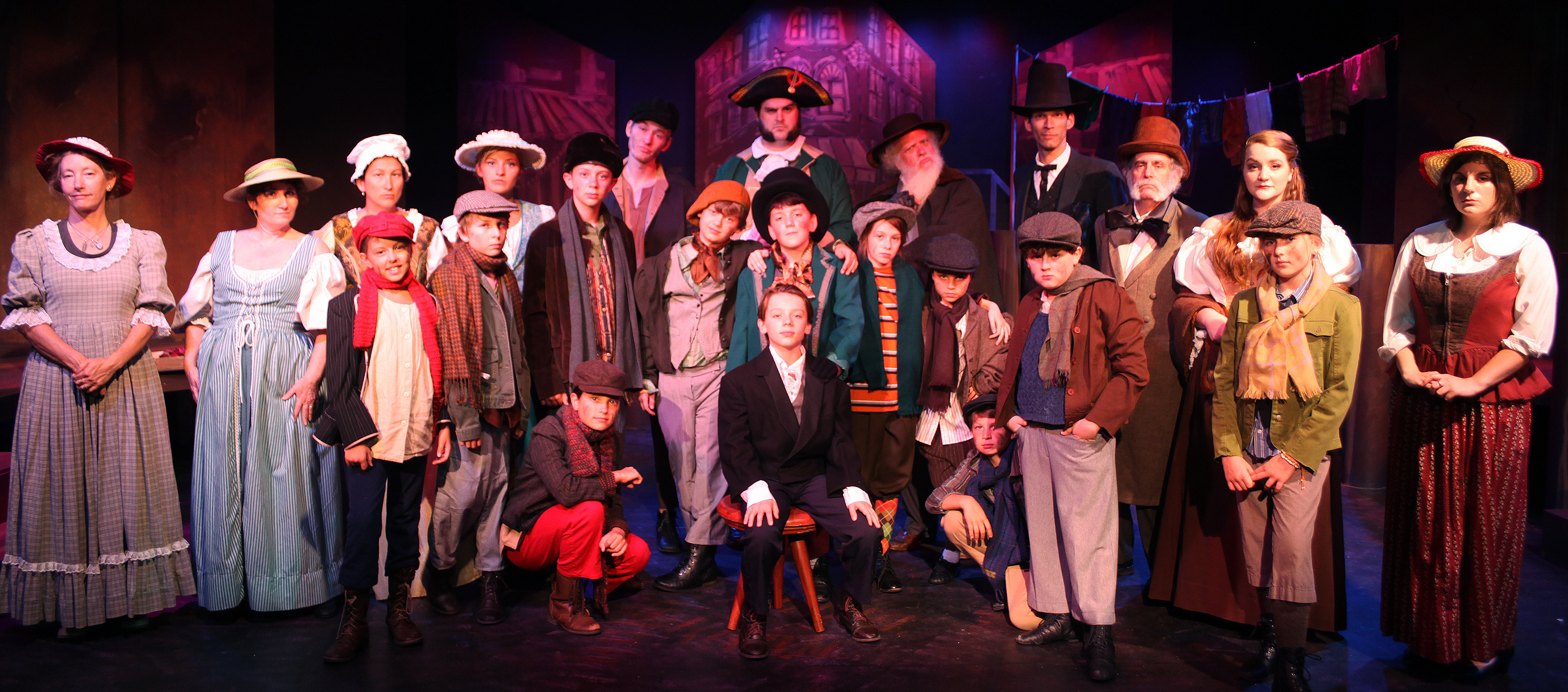 The cast of Oliver!, on stage June 5 through July 6 at Limelight Theatre, 11 Old Mission Ave. Photo by RENEE UNSWORTH