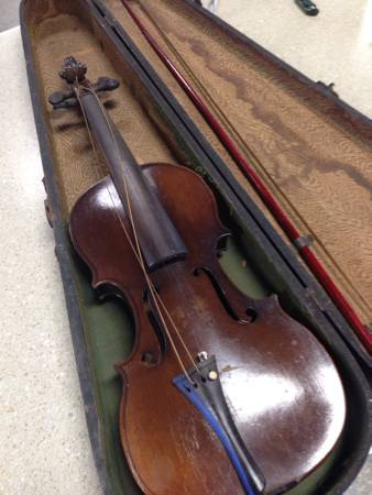 The asking price for this 98-year-old violin is $150 at Haven Hospice Attic Upscale Resale Store on U.S. 1 South in St. Augustine. Photo by CAROL ALBANESI