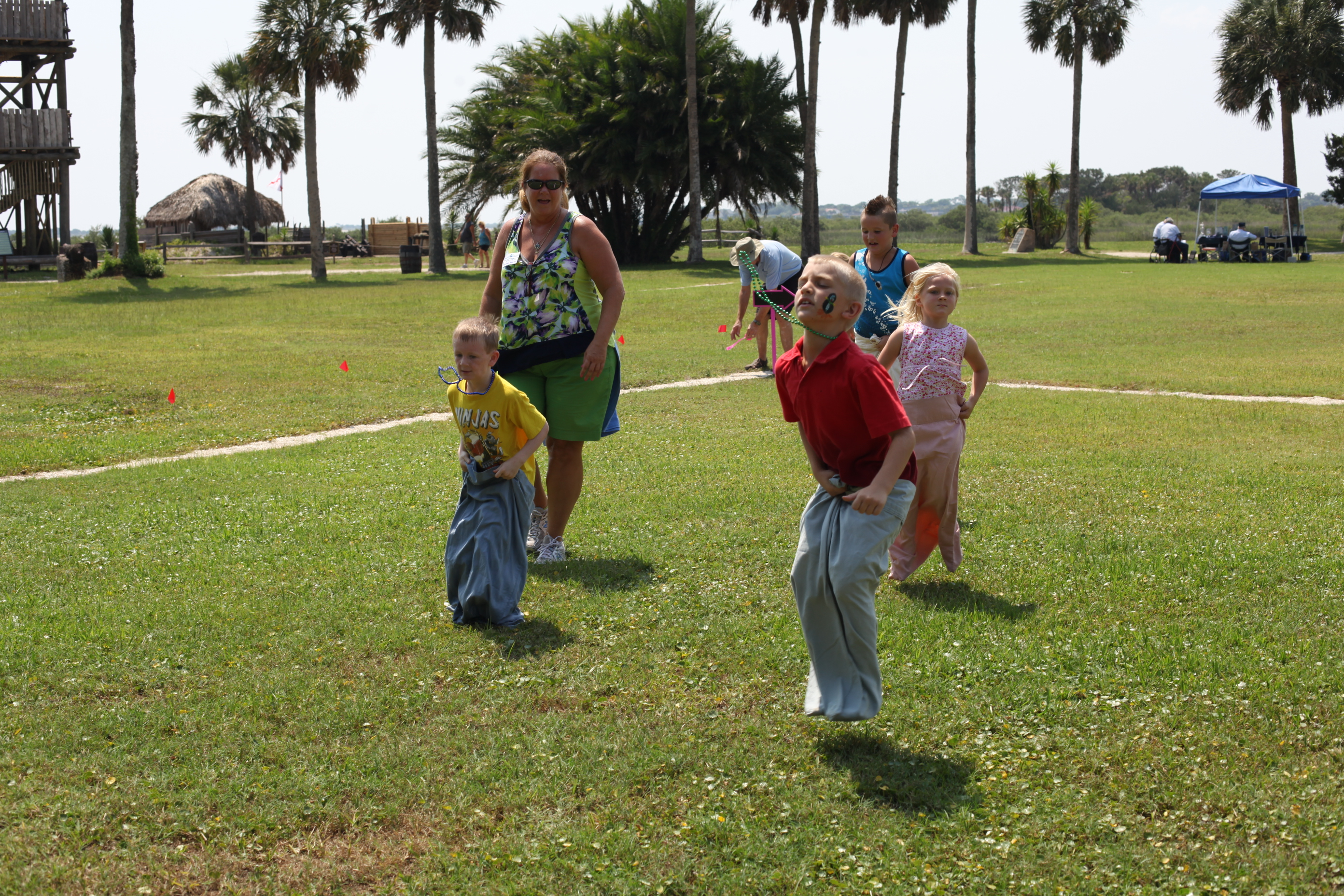 Children participate in a sack race on June 22 during the Maritime Heritage Family Fun Event at the Fountain of Youth in St. Augustine. Photos by RENEE UNSWORTH