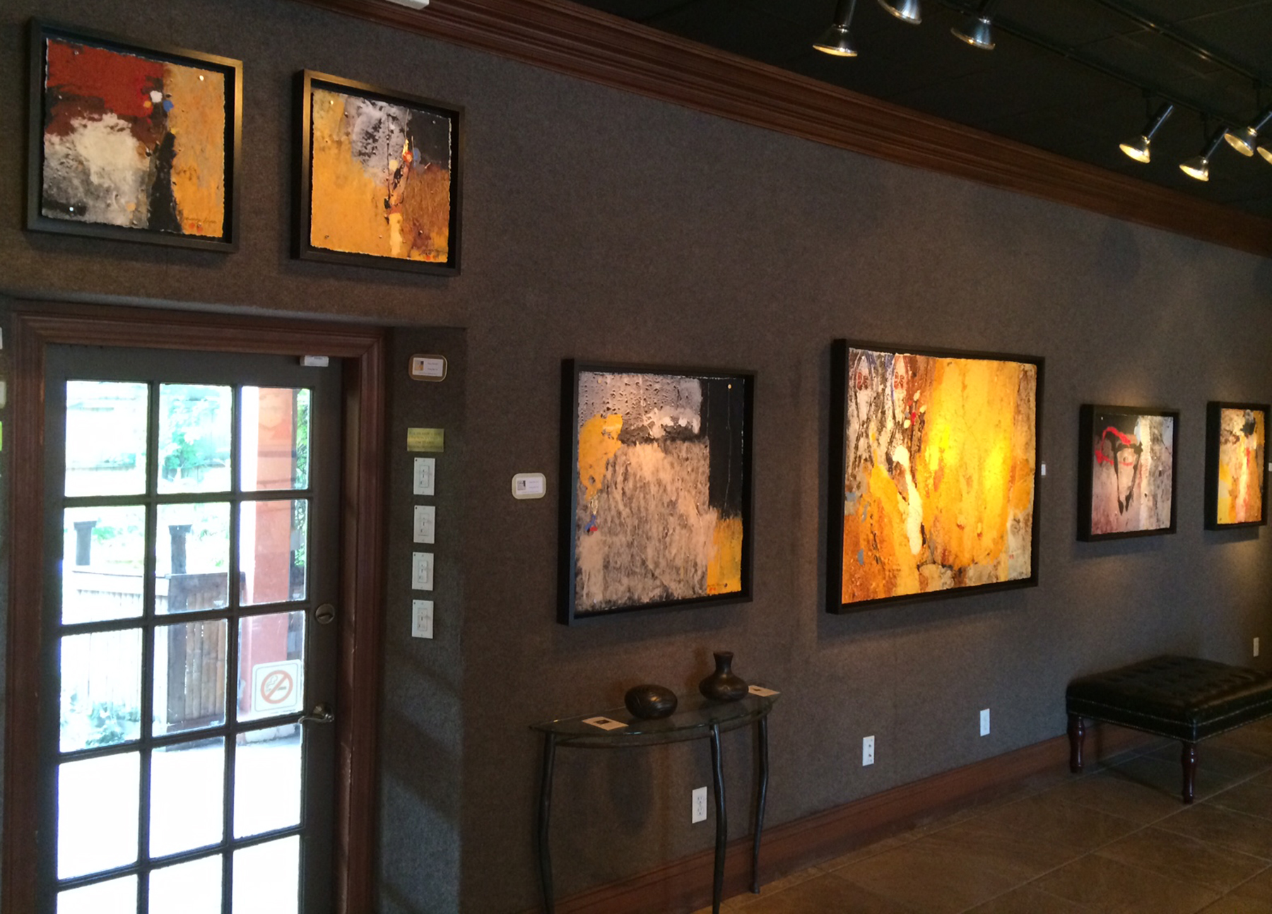 Artwork by the Yuns, on view on the walls of Galeria del Mar, 9 King St.