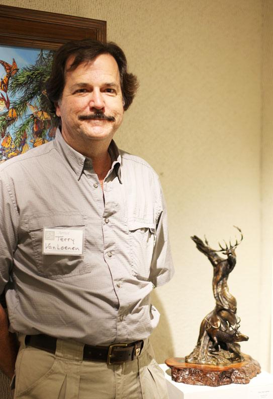 """Terry Van Loenen, Best in Show Award Winner with his """"Double Bull"""" bronze sculpture. Photo by RENEE UNSWORTH"""