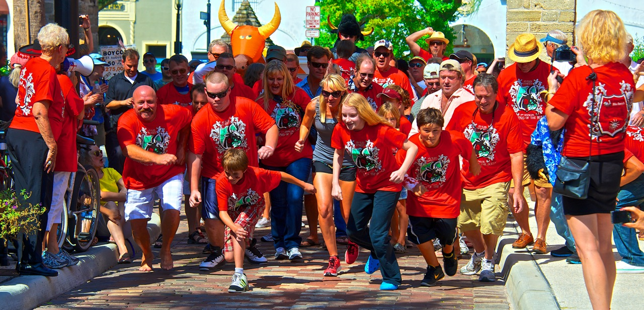 Running of the Bulls participants on Aviles Street race in the 2013 event. Contributed image