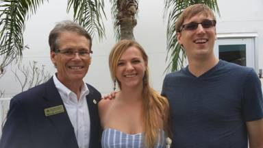 Contest winner Jessica Duvall and friend Phillip, at right, with Richard Goldman, executive director of the  St. Johns County Convention & Visitors Bureau.