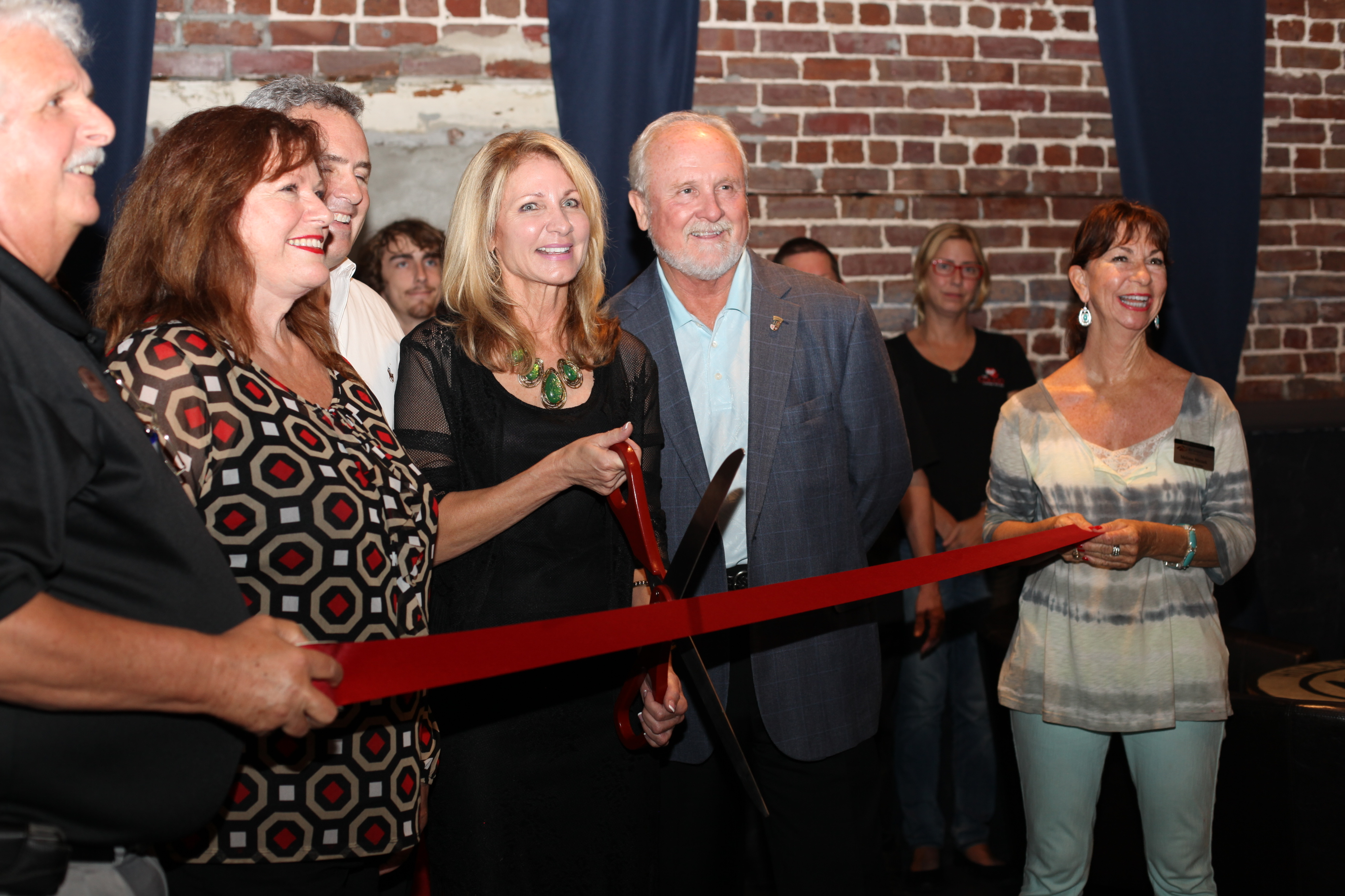 The Corazon Cinema and Cafe owner Karla Wagner, center, with St. Augustine Mayor Joe Boles officially open the renovated movie house during a ribbon cutting on Friday, Sept. 26. Photo by Renee Unsworth