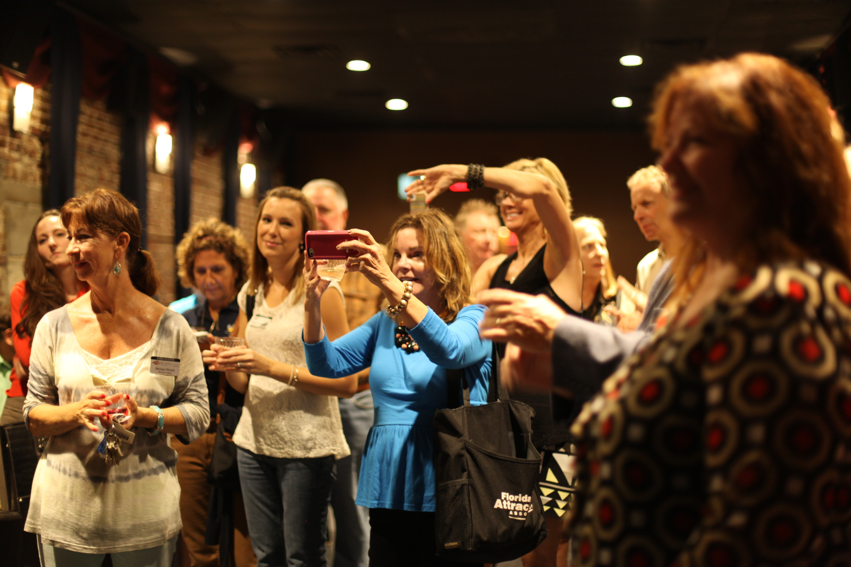 Guests to The Corazon Cinema & Cafe take photos during the ribbon cutting on Friday, Sept. 26.