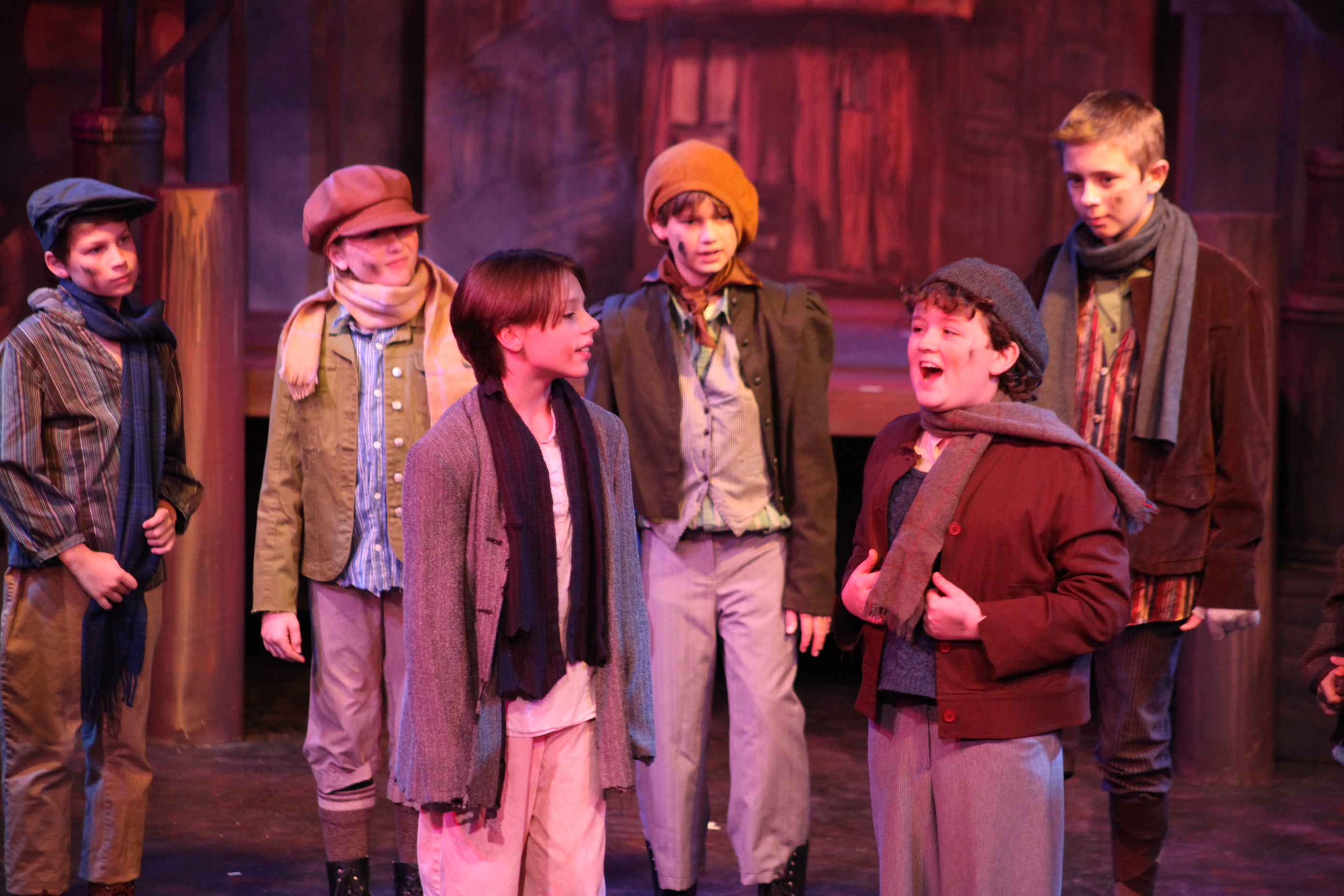 Evan Gray, in front on the right, sings during Oliver! at Limelight Theatre in June 2014. Evan will play Pugsley in The Addams Family at Limelight Theatre (Sept. 18-Oct. 19), then will leave for a national tour of A Christmas Story The Musical.