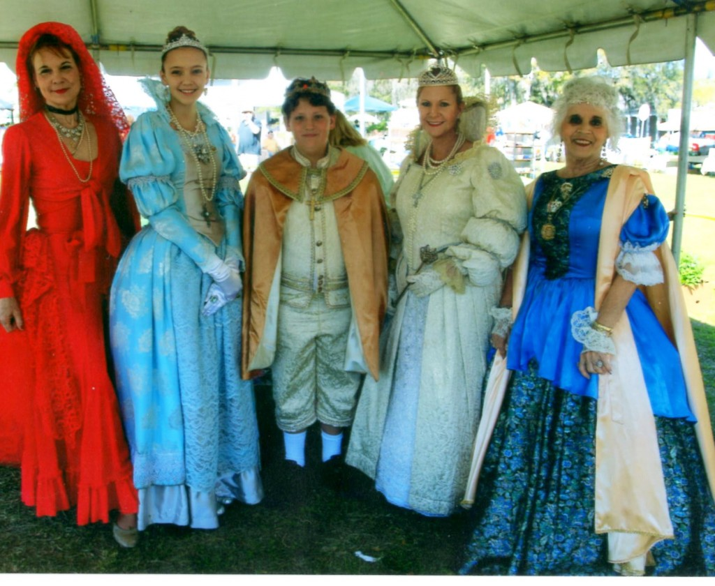 Spanish Dancer Julia Fredricks with Royal Family Trio  Christine Marie Capallia, portraying Queen Marianna; Tyler Ashton Baker as King Carlos; and Kaitlyn Green as Princess Margarita Maria. At right is past queen Sally Reyes Walton