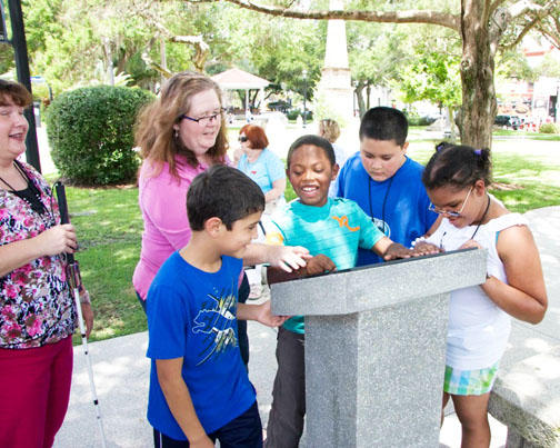 Students from the Florida School for the Deaf and the Blind learn about St. Augustine public art and students on the TOUCH St. Augustine Braille Trail, a community project by the St. Augustine Art Association. Contributed image
