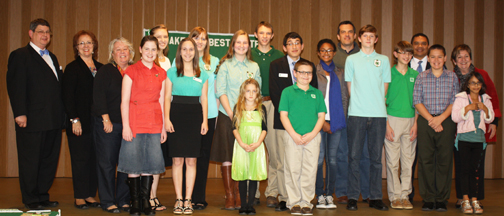 4-H Public Speaking winners and Kiwanis members gather for a group photo.