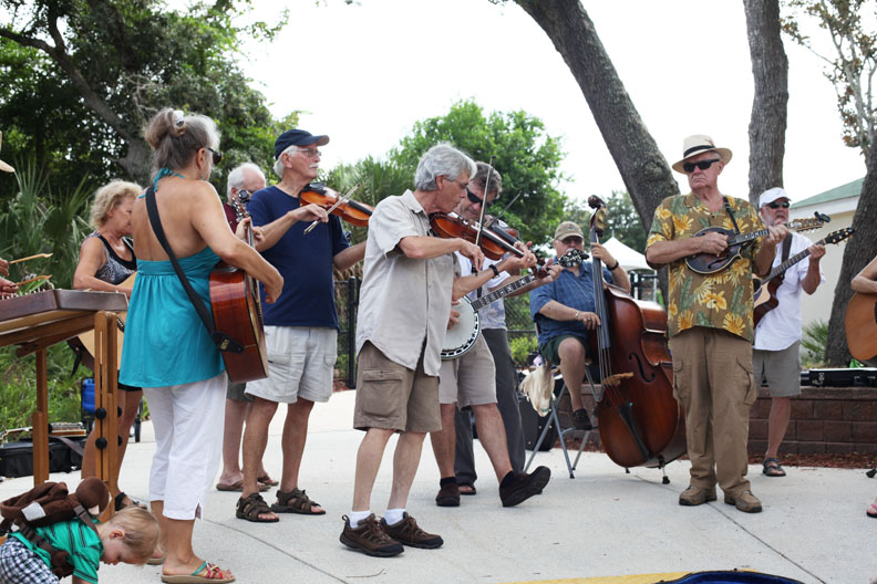 A group of musicians come together every Saturday during the Old City Farmers Market at the St. Augustine Amphitheatre. See event details in the list below. Photo by Renee Unsworth
