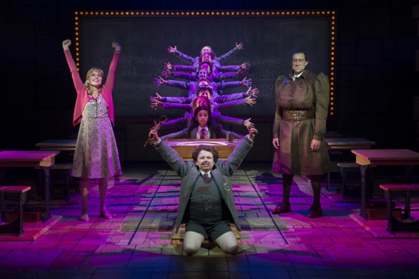 Jennifer Blood (L), Evan Gray (front center), Bryce Ryness (R), Gabby Gutierrez (center middle) and the Company of Matilda the Musical First National Tour. Photo from broadwayworld.com
