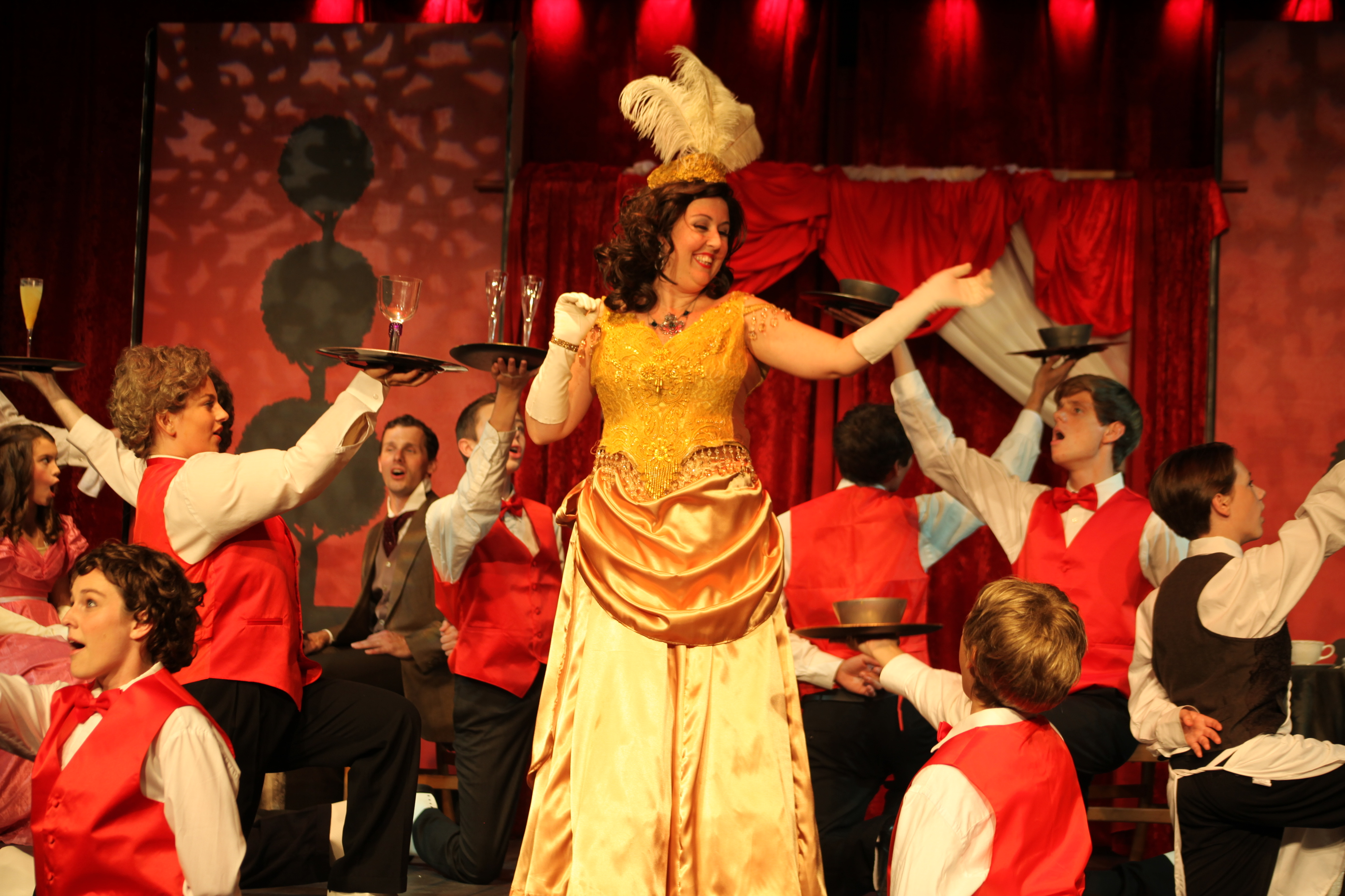 Kristin Pidcock as Dolly Levi, and the cast of servers in the cafe scene of Hello, Dolly at Limelight Theatre, on stage through July 5. Photo by Renee Unsworth