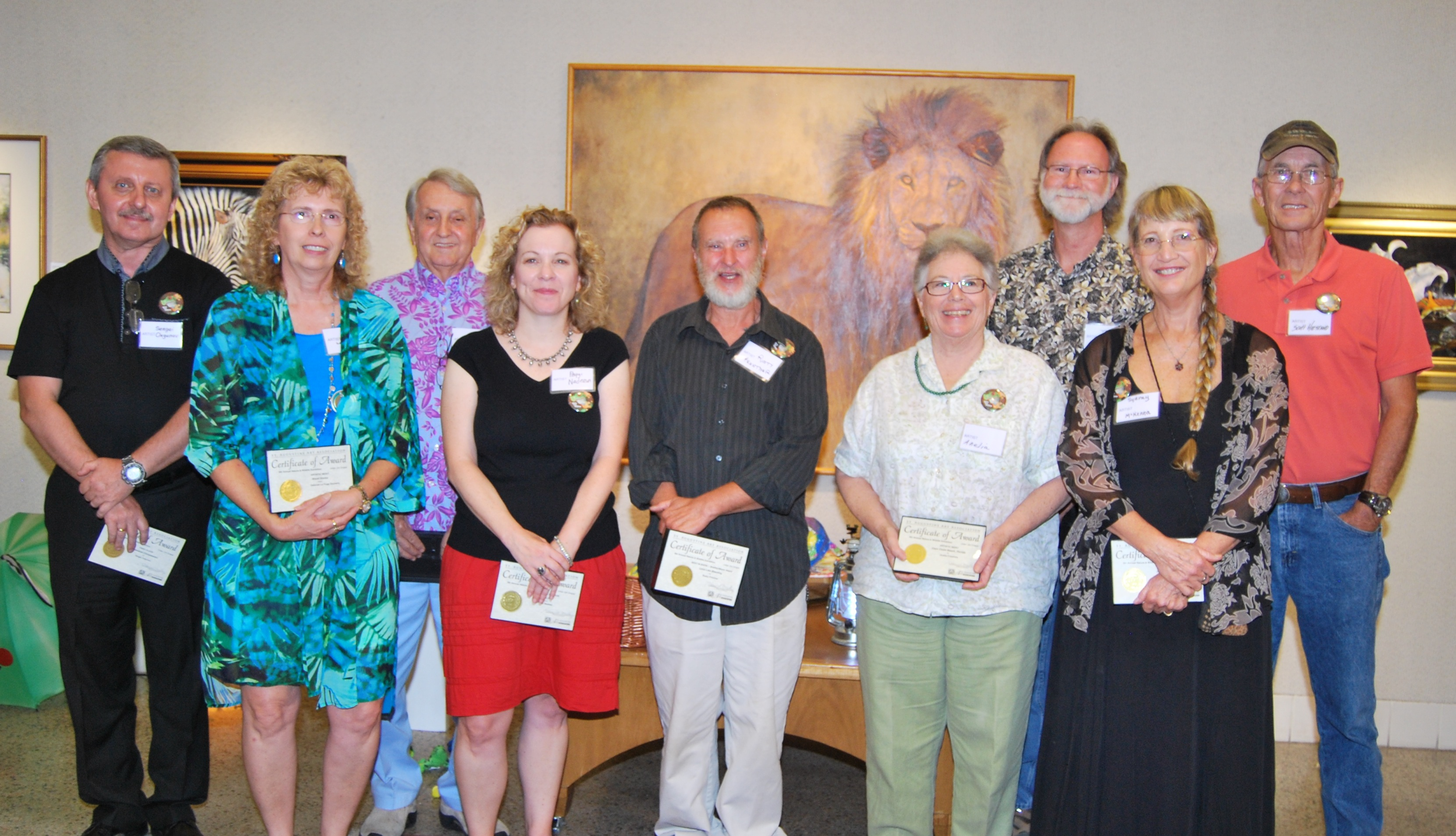 Award winning artists from the 6th Annual Nature & Wildlife Exhibit (l to r) Sergei Orgunov, Deborah LaFogg Docherty, Bill Morris, Peggi Nadeau, Rusty Frentner, Anelia Crawford, Ted Head, Sydney McKenna, Scott Hiestand (not shown: Brandon Lutterman, John Doddato, Monique Lazard) (Photo by Laine Quinn)