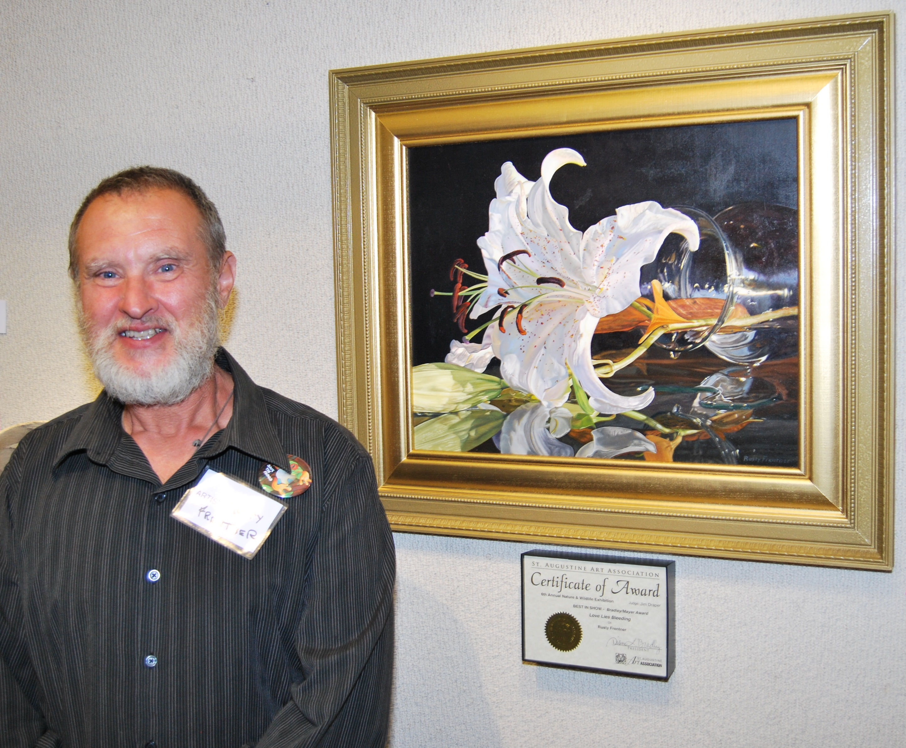 Rusty Frentner with Love Lies Bleeding, the 6th Annual Nature & Wildlife Exhibit Best in Show Winner (Photo by Laine Quinn)