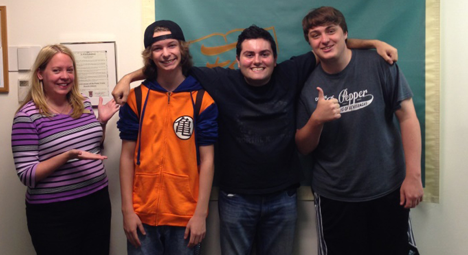 Three members of the Ponte Vedra Beach Library VolunTeen Gaming Team who have passed the torch on to keep Teen Gaming Nights going: Anne Crawford,  Zeryn Inman, Bryan Martins, and Sean Murphy.