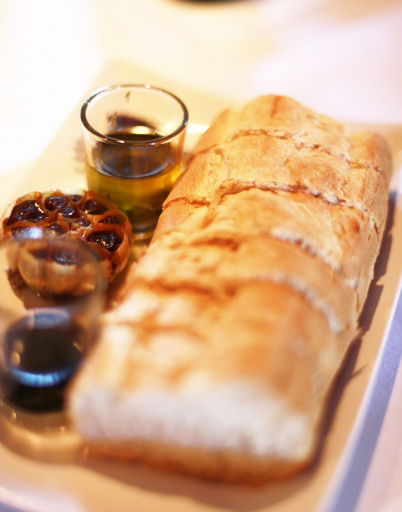 Bread with roasted garlic, olive oil, and balsamic vinegar is a romantic start to a meal at Old City House, Photo by Renee Unsworth