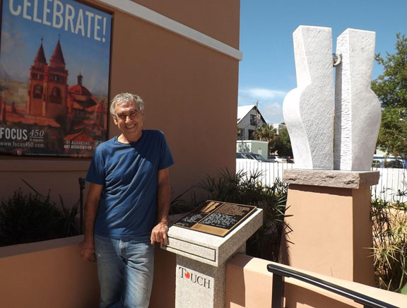 """Sculptor Enzo Torcoletti with his """"Heavenly Bodies"""" sculpture and Braille marker. (Photo by Elyse Brady)"""