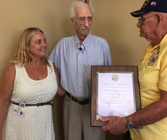 """.): Haven Hospice St. Augustine Volunteer Coordinator Michelle Colee, Bernard """"Bern"""" Ormont and Haven Hospice Veteran Volunteer Herb Zieglmeier."""