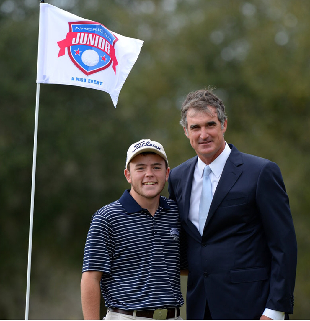 Andrew Alligood is congratulated after winning the 2014 American Junior golf tournament by World Junior Golf Series President Ton Burnett.