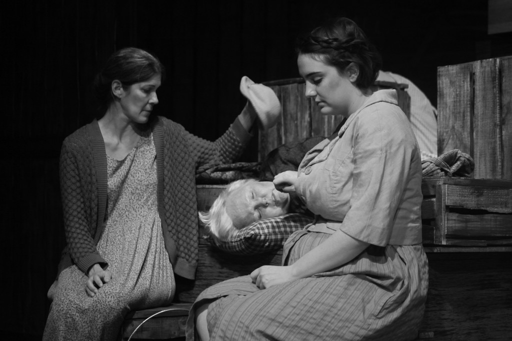 Jessica Ferris as Ma Joad; Vanessa Warner as Granma Joad; and ? as Rose of Sharon, in a scene from The Grapes of Wrath, on stage through Feb. 14 at Limelight Theatre. Photo by Renee Unsworth