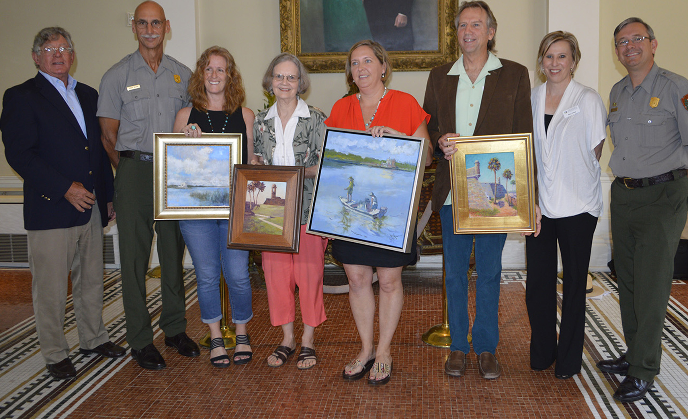 Five artists received awards as part of the Find Your Park Plein Air juried show, pictured from left to right Andrew Witt, executive director of St. Johns Cultural Council; Gordon Wilson, superintendent of Castillo de San Marcos and Fort Matanzas National Monuments; Lyn Asselta, best of show award recipient; Gail Beveridge, best of media: painting award recipient; Claire Kendrick, honorable mention award recipient; William Lurcott, best of media: pastel award recipient; Amy Crane, program director at The Community Foundation for Northeast Florida; and Steven Roberts, chief of interpretation and education at Castillo de San Marcos and Fort Matanzas National Monuments.