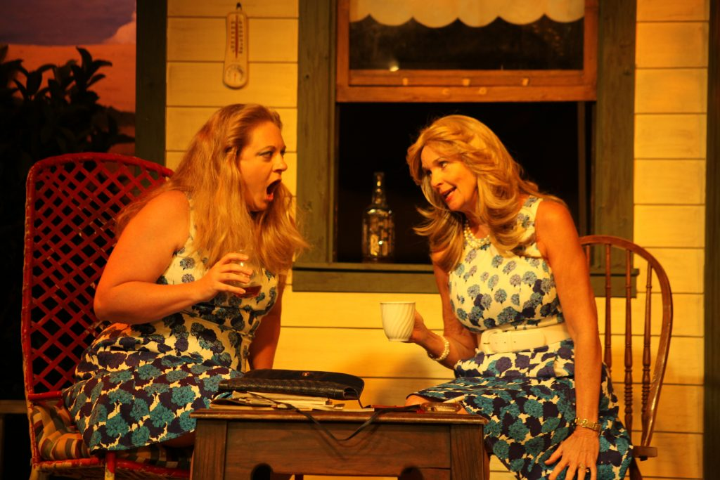 Cathy O'Brien as Hattie and Linda Mignon as Amy Lee gossip in Laundry & Bourbon, on stage June 3-26 at Limelight Theatre. Lone Star, another one-act, follows Laundry & Bourbon in the black box space. Photo by Renee Unsworth